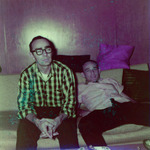 Two men sitting on a couch