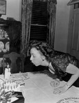 Mary blowing out candles on a birthday cake