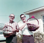 Two men holding Easter baskets