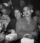 Man in drag sitting on a woman's lap