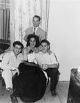 Drag queen posing with three men