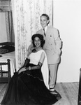 Drag queen posing with a man in a suit