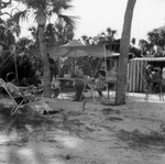 Kay Thompson's friends under a canopy at the beach