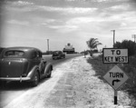 Automobiles driving toward the Overseas Highway and Key West