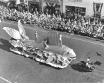 Fish-shaped float sponsored by the Rotary, Civitans, Exchange, Lions, and Optimists Clubs of Tampa in the Gasparilla Parade