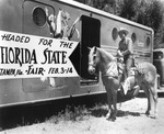 Roy Rogers and his horse, Trigger, next to a horse trailer advertising the Florida State Fair
