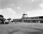 Tampa International Airport terminal building with DC-6 airplane on tarmac