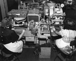Women making cigars at machines at the Swann Products, Incorporated