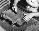 Woman cigar maker readying a tobacco leaf at Cuesta Rey and Company