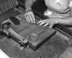 Woman cigar maker rolling a cigar at Cuesta Rey and Company