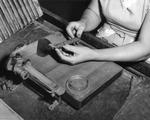 Woman cigar maker wrapping a cigar at Cuesta Rey and Company