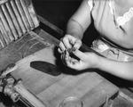 Woman finishing a cigar at Cuesta Rey and Company