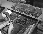 Woman rolling cigars at Cuesta Rey and Company