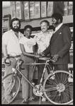 Cleveland Johnson presenting bike to kid.