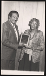 Cleveland Johnson presenting an award to Victoria Lawson.