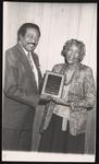 Cleveland Johnson presenting an award to Victoria Lawson.