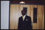 Gentleman in front of double-doors.