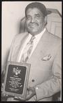Thomas Stockton holding his Teacher of the Year Award