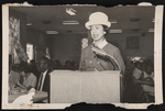Woman speaking at a luncheon.
