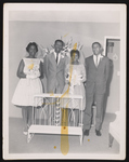 Four people at a wedding ceremony