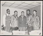 Five gentlemen standing in front of a microphone