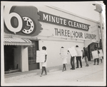 Group of men and women picketing outside of 6 Minute Cleaners