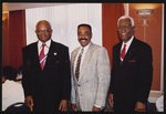 Two gentlemen and Ernest Williams at an event