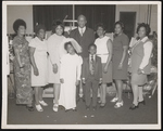 Reverand James Jackson and group of people inside a church