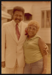 Cleveland Johnson and posing with woman