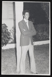 Gentleman standing in front of a palm tree
