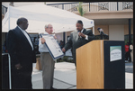 Gentleman presenting an award at an event at Johnnie Ruth Clarke Health Center at the Historic Mercy Hospital Campus.