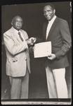 Gentleman being presented an award