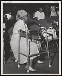 Elderly woman, seated