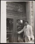 Reverend Preston D.H. Leonard outside the Municipal Building