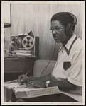 Unidentified man listening and taking notes