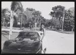 Rene Robinson standing beside a car