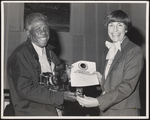 W. L. Jones receiving a Certificate of Appreciation and the Key to the City by Mayor Corinne Freeman