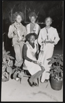 Four young women posing with trophies won at a pageant