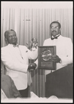 Robert L. Creal presenting Mortician of the Year Award to George Sabb