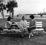Female students on bench at USF St. Petersburg campus, circa 1969