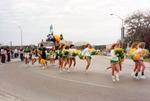 Cheerleaders leading homecoming float, circa 1985